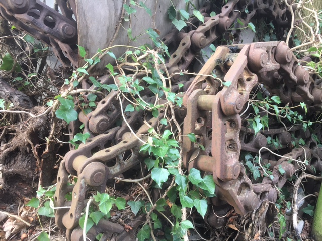 machinery chain entangled in hedgerow