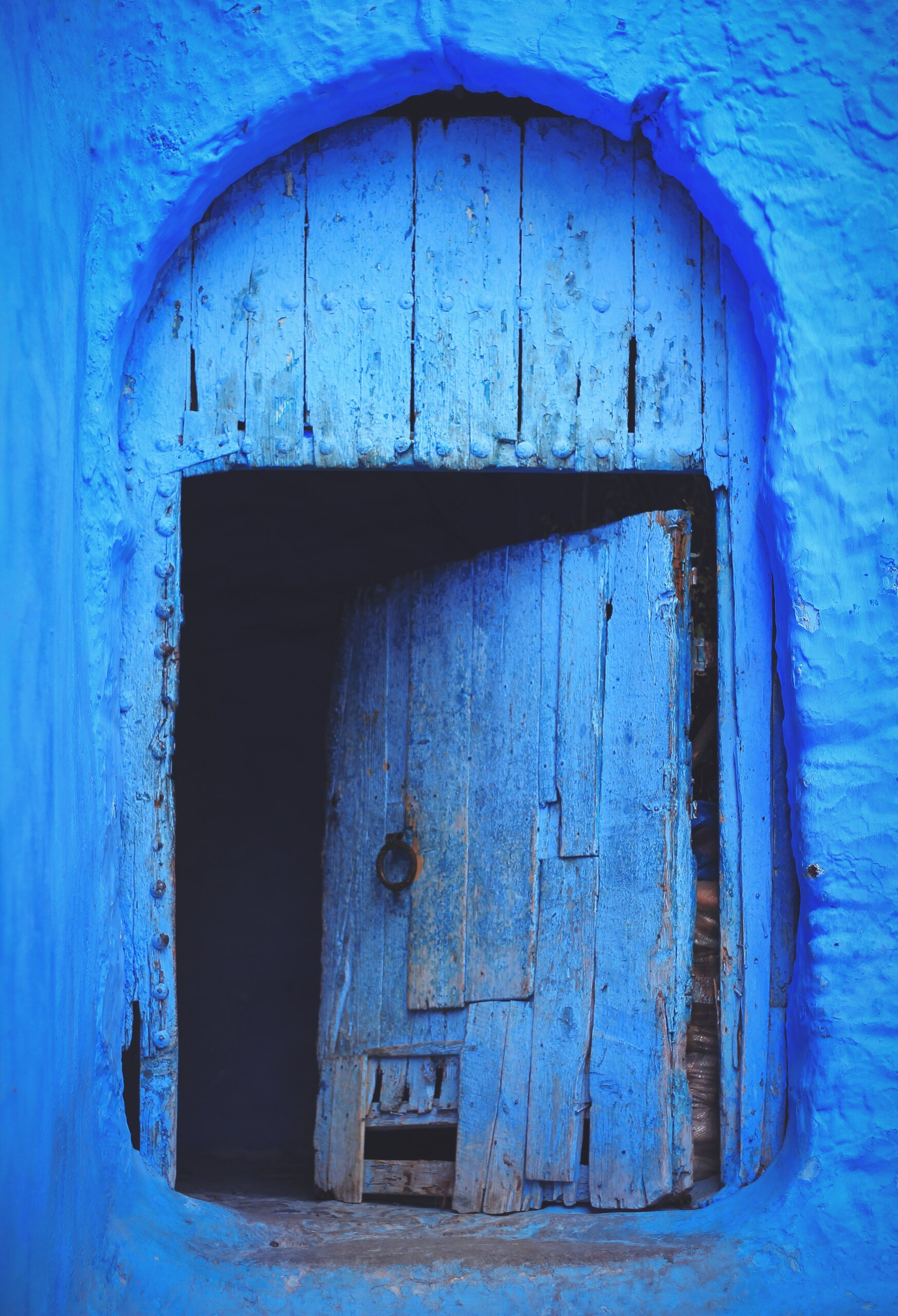 blue wooden door in wall opening inwards