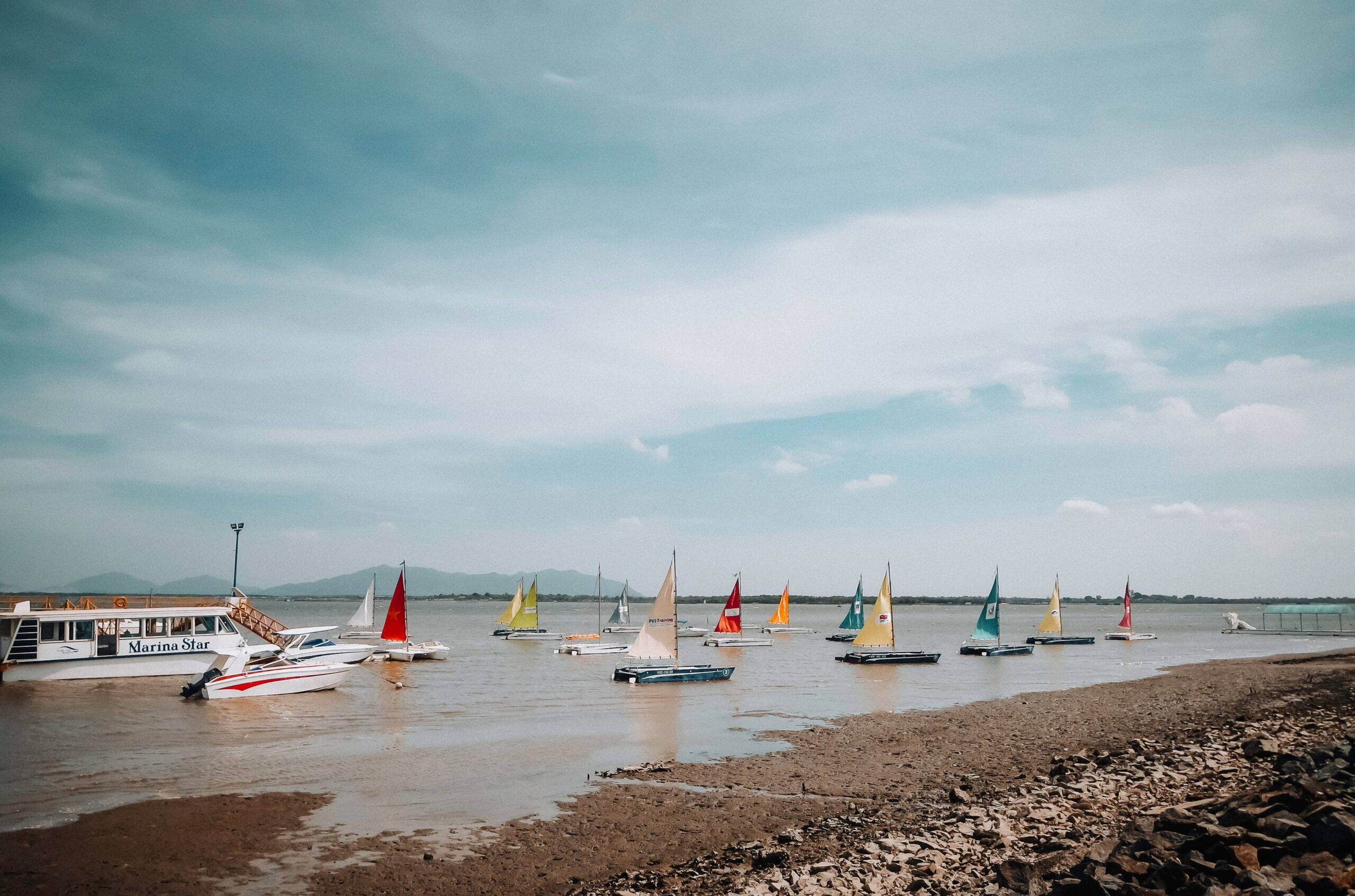 sailing boats by sea shore