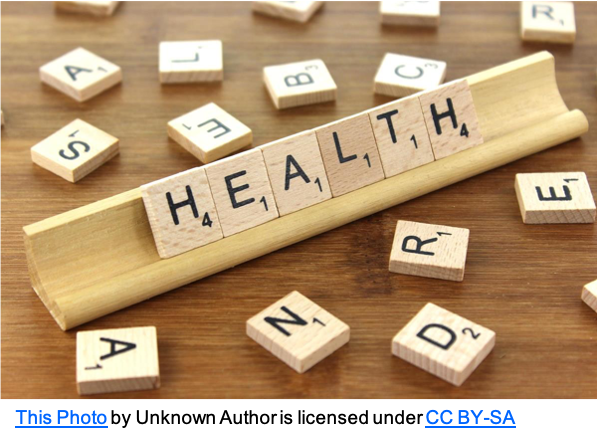 Health on rack in scrabble tiles with scatter of other tiles
